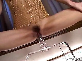 Japanese babe with a big dildo uncensored