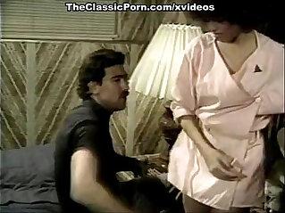 Kelly Nichols, Kristara Barrington, Blossom Lei in classic scene