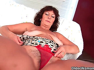 Busty lady Alma rubs her hairy cunt with her fingers