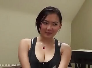 Very cute Asian masseuse gives blowjob