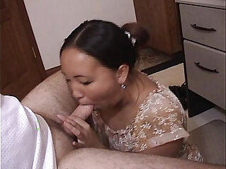 Asian Brunette eating cock and cum